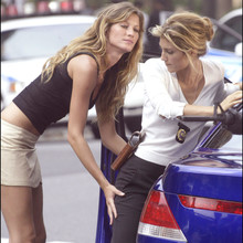 "© Steve Sands/ABACA. 50051-2. New York City-NY-USA, 20/09/2003. Giselle Bundchen  gives Jennifer Esposito a serious pat down after capturing her while playing a bank robber filming ""Taxi"" with Queen Latifah  and Jimmy Fallon in NYC. Fallon and Esposito play NYC cops while Latifah plays a NYC cab driver."