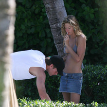 EXCLUSIVE: Brazilian supermodel Gisele Bundchen shares a passionate kiss with American football star Tom Brady