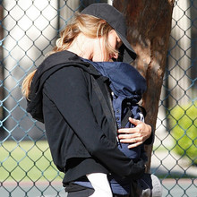 40017, SANTA MONICA, CALIFORNIA - Thursday April 29, 2010. Tom Brady and wife Gisele Bundchen spend time with their 5-month old son Benjamin and Tom's older son John Edward Moynahan at a playground in Santa Monica. The couple recently spent an estimated $20 million to build an eight-bedroom, 22m000 square-foot mansion in Brentwood, complete with a weight room, a wine room, a six-car garage and a lagoon-shaped swimming pool and spa. Photograph: PacificCoastNews.com**FEE MUST BE AGREED PRIOR TO USAGE** **E-TABLET/IPAD & MOBILE PHONE APP PUBLISHING REQUIRES ADDITIONAL FEES** UK OFFICE:+44 131 557 7760/7761 US OFFICE:1 310 261 9676
