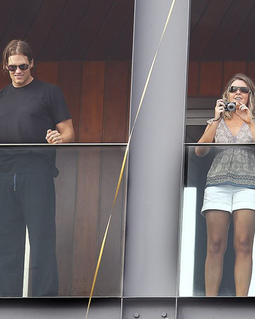 02 Tom Brady and Gisele Bundchen on their hotel balcony watching Rio Carnival in Brazil Marc