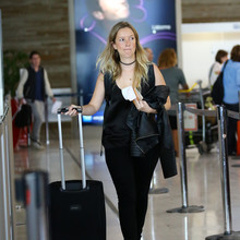 EXCLUSIVE Rafaela Bundchen, sister of Gisele, is seen arriving at Roissy airport (still carrying her black leather backpack that she took to the private clinic) to catch a flight to Miami