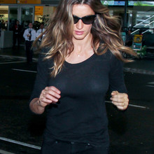 EXCLUSIVE: Gisele Bundchen accidentally shows off her famous cleavage as sheer top goes see-through