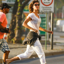 *EXCLUSIVE* Gisele Bündchen enjoys a beach sunrise with friends in Rio