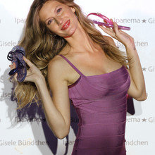 Brazilian model Gisele Bundchen poses for photographers during a photocall to present the 'Ipanema-Gisele Bundchen' sandals collection in Paris