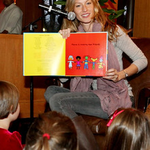 (120610  Boston, MA) Model Giselle Bundchen reads a book to children at the Four Seasons Hotel,  Monday,  December 06, 2010.  Staff photo by Angela Rowlings.
