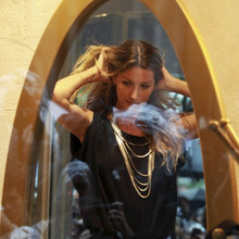Brazilian model Gisele Bundchen performs during a photocall to present her collection created by C&A store in Sao Paulo