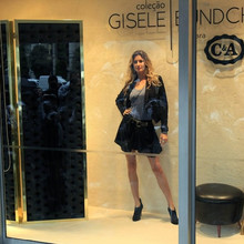 Brazilian model Gisele Bundchen parades during a photocall to present her collection created by C&A store in Sao Paulo