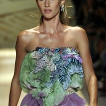 Brazilian model Gisele Bundchen displays a creation from the Colcci Spring/Summer collection during Sao Paulo Fashion Week